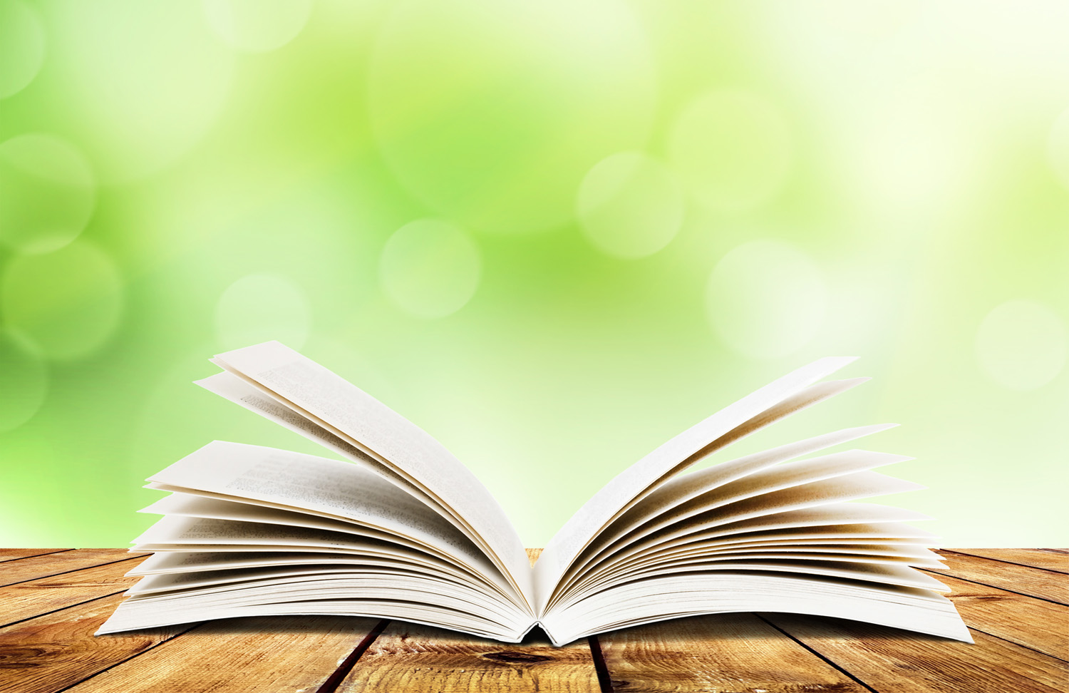 open_book_green_background_11572282912